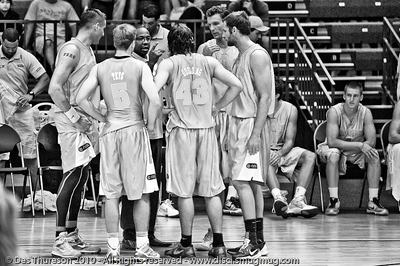 "(Alternate Processing) - Blaze coach Joey Wright gives his troops the ""full counsel"" - Pre-Season NBL International Basketball: Gold Coast Blaze v Anyang KT & G Kites - Korea; Logan City, Queensland, Australia; 2010. (Lightroom Preset: ""Hardcore Acros"".)"