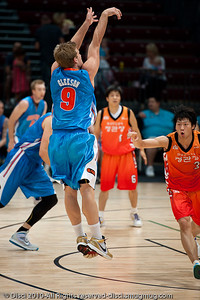 Shaun Gleeson shows copy-book shooting style - Pre-Season NBL International Basketball: Gold Coast Blaze v Anyang KT & G Kites - Korea; Logan City, Queensland, Australia; 2010.