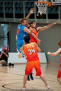Brendan Teys looks for the dump pass whilst under heavy pressure - Pre-Season NBL International Basketball: Gold Coast Blaze v Anyang KT & G Kites - Korea; Logan City, Queensland, Australia; 2010.
