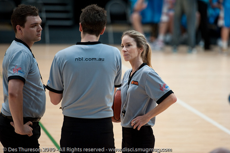 Toni Caldwell listens as Vaughan Mayberry addresses the team - Pre-Season NBL International Basketball: Gold Coast Blaze v Anyang KT & G Kites - Korea; Logan City, Queensland, Australia; 2010.