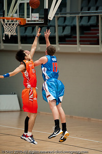 Anthony Petrie goes strong to the hoop. Pre-Season NBL International Basketball: Gold Coast Blaze v Anyang KT & G Kites - Korea; Logan City, Queensland, Australia; 2010.