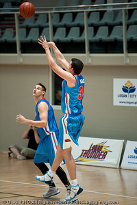 Veteran recruit Stephen Hoare does one of the many things he does best: shoots the medium range jump-shot - Pre-Season NBL International Basketball: Gold Coast Blaze v Anyang KT & G Kites - Korea; Logan City, Queensland, Australia; 2010.