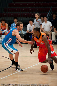 Anthony Petrie not wanting to get beaten - Pre-Season NBL International Basketball: Gold Coast Blaze v Anyang KT & G Kites - Korea; Logan City, Queensland, Australia; 2010.