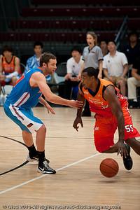 Anthony Petrie not wanting to get beaten - Pre-Season NBL International Basketball: Gold Coast Blaze v Anyang KT & G Kites - Korea; Logan City, Queensland, Australia; 2010.