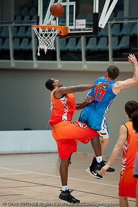 Anthony Petrie receives the foul as he goes strong to the hoop. Pre-Season NBL International Basketball: Gold Coast Blaze v Anyang KT & G Kites - Korea; Logan City, Queensland, Australia; 2010.
