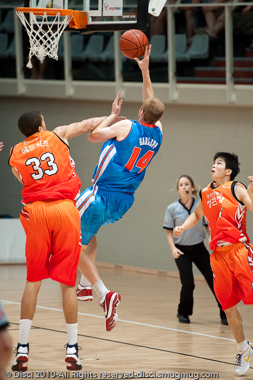 Recruit Tom Garlepp goes strong against heavy contact - Pre-Season NBL International Basketball: Gold Coast Blaze v Anyang KT & G Kites - Korea; Logan City, Queensland, Australia; 2010.