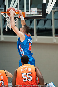 Pero Vasiljevic scores on the alley-oop in one of the first plays of the game - Pre-Season NBL International Basketball: Gold Coast Blaze v Anyang KT & G Kites - Korea; Logan City, Queensland, Australia; 2010.