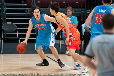 Chris Goulding runs the offence - Pre-Season NBL International Basketball: Gold Coast Blaze v Anyang KT & G Kites - Korea; Logan City, Queensland, Australia; 2010.