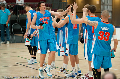 New veteran recruit Stephen Hoare greets his new team mates - Pre-Season NBL International Basketball: Gold Coast Blaze v Anyang KT & G Kites - Korea; Logan City, Queensland, Australia; 2010.