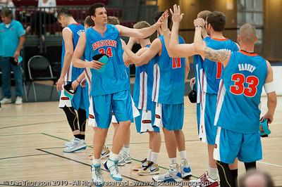 New veteran recruit Stephen Hoare greets his new team mates - Pre-Season NBL International Basketball: Gold Coast Blaze v Anyang KT & G Kites - Korea; Logan City, Queensland, Australia; 2010.