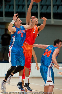 Pero Vasiljevic competes inside - Pre-Season NBL International Basketball: Gold Coast Blaze v Anyang KT & G Kites - Korea; Logan City, Queensland, Australia; 2010.