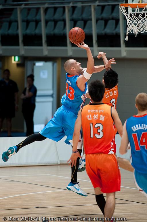 James Harvey attacks the defence - Pre-Season NBL International Basketball: Gold Coast Blaze v Anyang KT & G Kites - Korea; Logan City, Queensland, Australia; 2010.