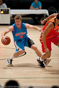 Shaun Gleeson maintains posession under good pressure - Pre-Season NBL International Basketball: Gold Coast Blaze v Anyang KT & G Kites - Korea; Logan City, Queensland, Australia; 2010.