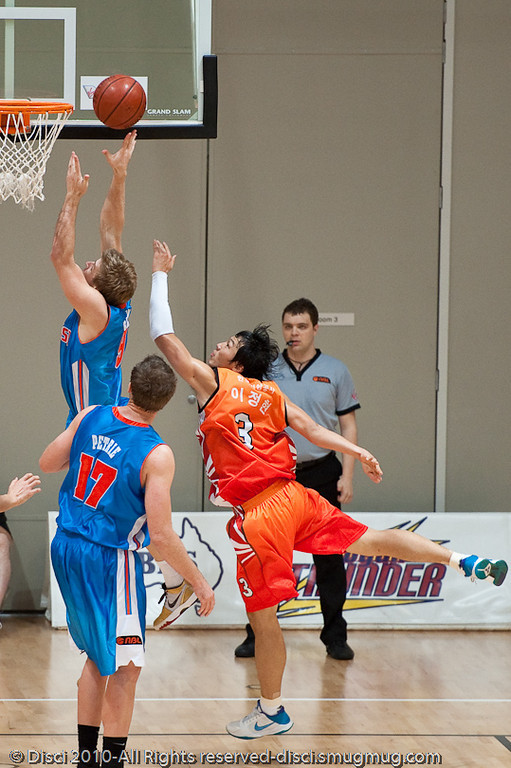 Shaun Gleeson lays up at the far end - Pre-Season NBL International Basketball: Gold Coast Blaze v Anyang KT & G Kites - Korea; Logan City, Queensland, Australia; 2010.