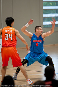 Pero Vasiljevic shows his defensive stance to coach Joey Wright - Pre-Season NBL International Basketball: Gold Coast Blaze v Anyang KT & G Kites - Korea; Logan City, Queensland, Australia; 2010.