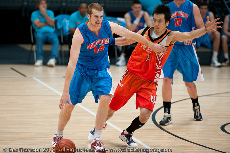 Tom Garlepp uses all 4 limbs... - Pre-Season NBL International Basketball: Gold Coast Blaze v Anyang KT & G Kites - Korea; Logan City, Queensland, Australia; 2010.
