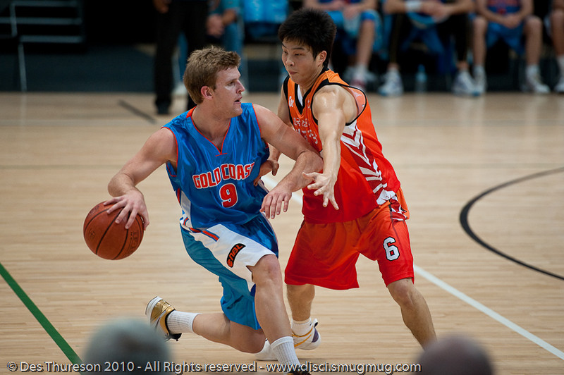 Shaun Gleeson maintains posession under good pressure - Pre-Season NBL International Basketball: Gold Coast Blaze v Anyang KT & G Kites - Korea; Logan City, Queensland, Australia; 2010.