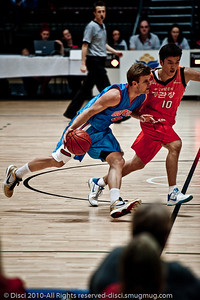 "Shaun Gleeson maintains posession under good pressure - Pre-Season NBL International Basketball: Gold Coast Blaze v Anyang KT & G Kites - Korea; Logan City, Queensland, Australia; 2010.  (Lightroom Preset: ""Dave Hill Temp"".)"