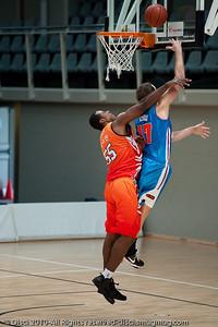 Anthony Petrie receives the foul as he goes strong to the hoop. Pre-Season NBL International Basketball: Gold Coast Blaze v Anyang KT & G Kites - Korea; Logan City, Queensland, Australia; 2010.