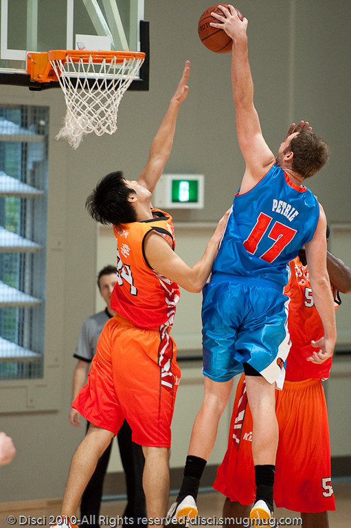 Anthony Petrie throws down the monster left-handed jam - Pre-Season NBL International Basketball: Gold Coast Blaze v Anyang KT & G Kites - Korea; Logan City, Queensland, Australia; 2010.