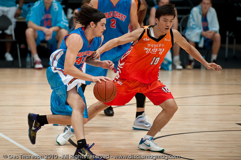 Chris Goulding runs the offence - Pre-Season NBL International Basketball: Gold Coast Blaze v Anyang KT & G Kites - Korea; Logan City, Queensland, Australia; 2010.