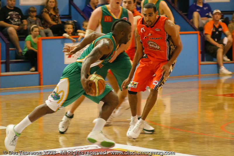 Corey Williams takes on Dave Thomas - Cairns NBL pre-season basketball tournament; Tropical North Queensland, Australia; August 2008.