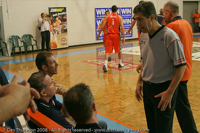 Allan Black, Mark Beecroft & Aaron Fearne (R to L) discuss officiating - Cairns NBL pre-season basketball tournament; Tropical North Queensland, Australia; August 2008.