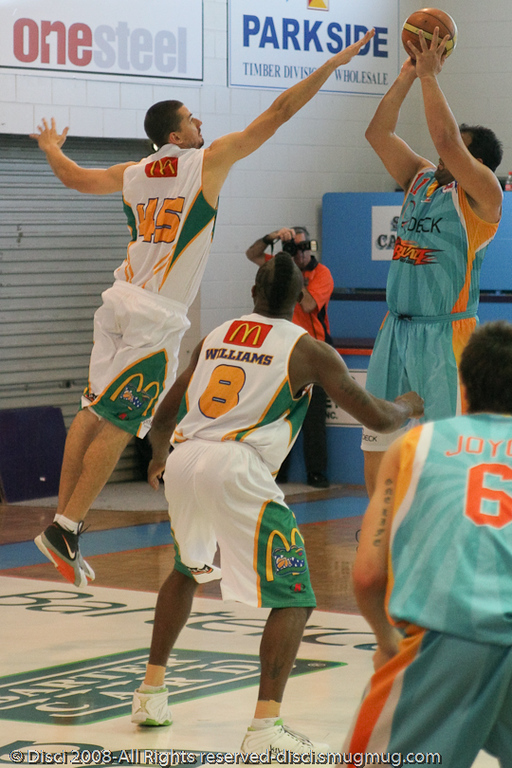 Russell Hinder (Rusty) gets out to Pero Cameron - Cairns NBL pre-season basketball tournament; Tropical North Queensland, Australia; August 2008.