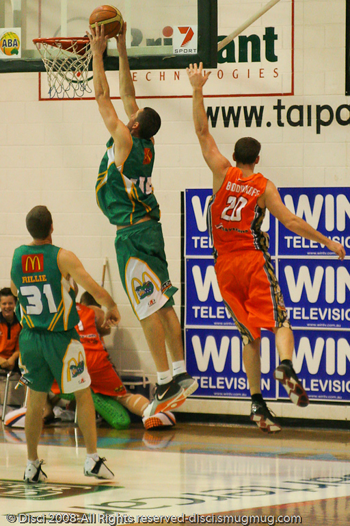 "To use a Steve Carfino term, the ""long"" Russell Hinder gets inside for the dunk - Cairns NBL pre-season basketball tournament; Tropical North Queensland, Australia; August 2008."