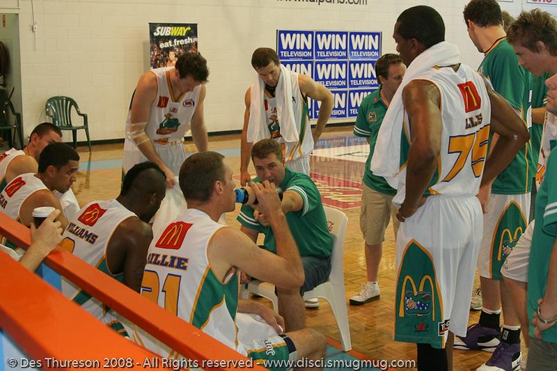Trevor Gleeson complains that John Rillie's hair is too long - Cairns NBL pre-season basketball tournament; Tropical North Queensland, Australia; August 2008.