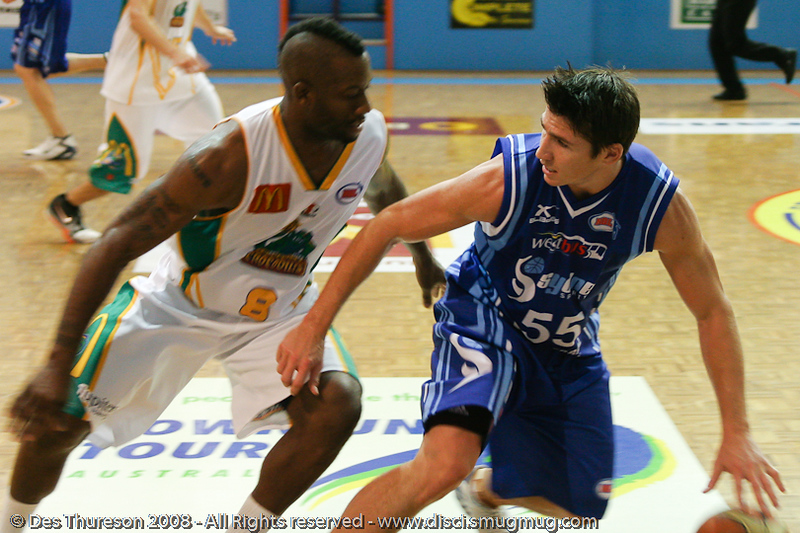 Damian Martin respects the defence of Corey Williams - Cairns NBL pre-season basketball tournament; Tropical North Queensland, Australia; August 2008.