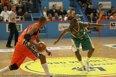 Corey Williams plays D on Darnell Mee - Cairns NBL pre-season basketball tournament; Tropical North Queensland, Australia; August 2008.