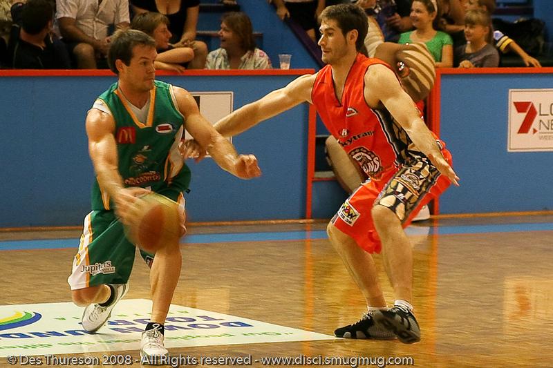 Scott Cook defends Kelvin Robertson - Cairns NBL pre-season basketball tournament; Tropical North Queensland, Australia; August 2008.