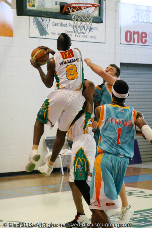 Corey Williams elevates for the layup - Cairns NBL pre-season basketball tournament; Tropical North Queensland, Australia; August 2008.