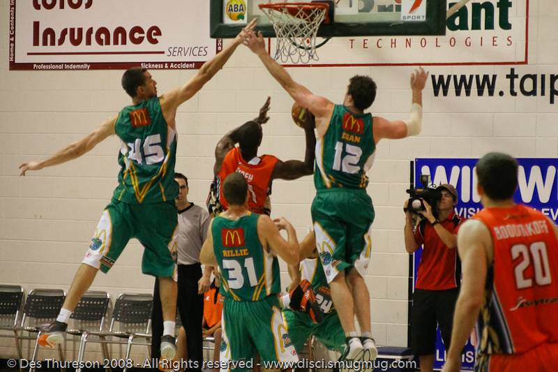 "If you thought the ""Triangle"" was just an offence - think again - Russell Hinder, Larry Abney and Daniel Egan - Cairns NBL pre-season basketball tournament; Tropical North Queensland, Australia; August 2008."