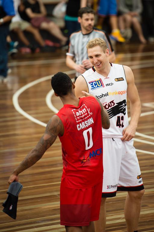 "Jahii Carson, Shawn Redhage - Perth Wildcats v Wollongong Hawks - 2014 NBL Blitz Basketball, NAB Stadium, Auchenflower, Brisbane, Qld, AUS. Day 3, Camera 1. Photos by Des Thureson - <a href=""http://disci.smugmug.com"">http://disci.smugmug.com</a>."