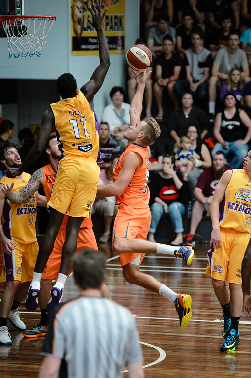 "Mitchell Young, Madol Chol - Cairns Taipans v Sydney Kings - 2014 NBL Blitz Basketball, NAB Stadium, Auchenflower, Brisbane, Qld, AUS. Day 3, Camera 1. Photos by Des Thureson - <a href=""http://disci.smugmug.com"">http://disci.smugmug.com</a>."