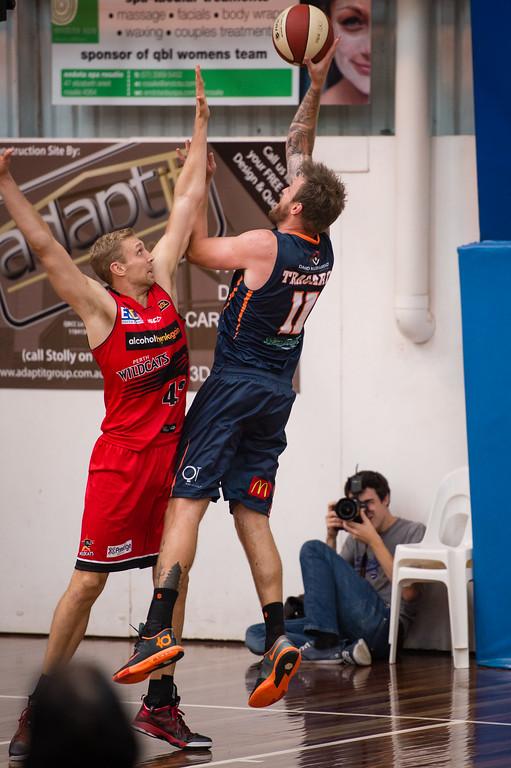 "Cam Tragardh, Shawn Redhage - Perth Wildcats v Cairns Taipans - 2014 NBL Blitz Basketball, NAB Stadium, Auchenflower, Brisbane, Qld, AUS. Day 2. Photos by Des Thureson - <a href=""http://disci.smugmug.com"">http://disci.smugmug.com</a>."