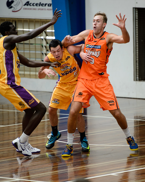"Jason Cadee, Mitchell Young - Cairns Taipans v Sydney Kings - 2014 NBL Blitz Basketball, NAB Stadium, Auchenflower, Brisbane, Qld, AUS. Day 3, Camera 1. Photos by Des Thureson - <a href=""http://disci.smugmug.com"">http://disci.smugmug.com</a>."