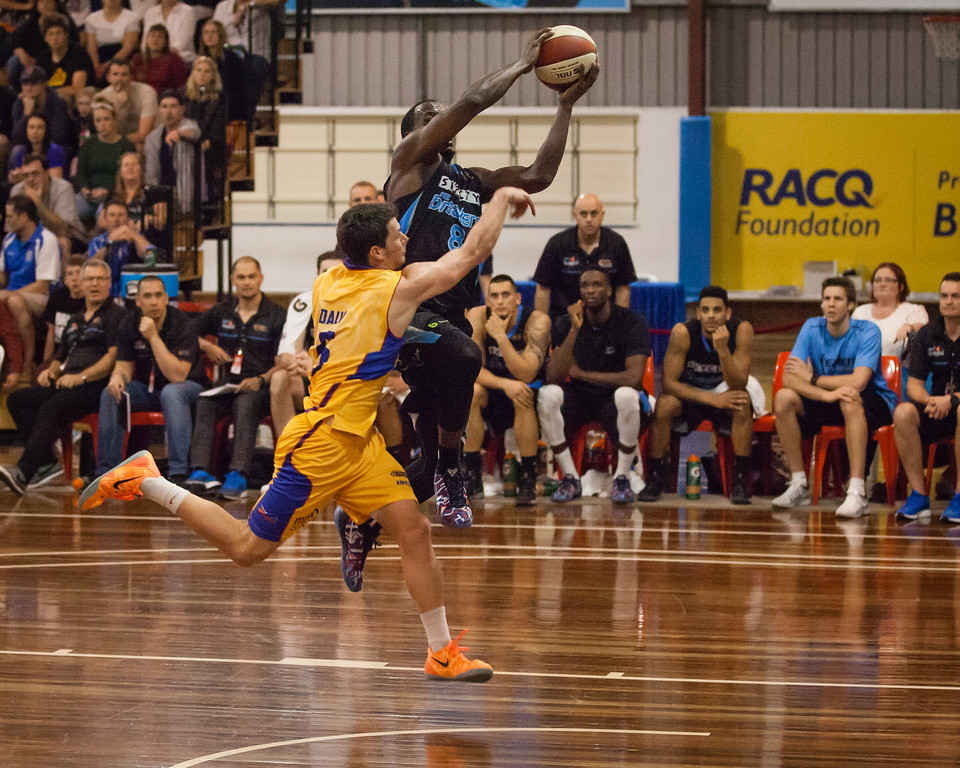 """Tom Daly, Cedric Jackson - Adelaide 36ers v New Zealand Breakers - 2014 NBL Blitz Basketball, NAB Stadium, Auchenflower, Brisbane, Qld, AUS. Day 1. Photos by Des Thureson - <a href=""""http://disci.smugmug.com"""">http://disci.smugmug.com</a>."""