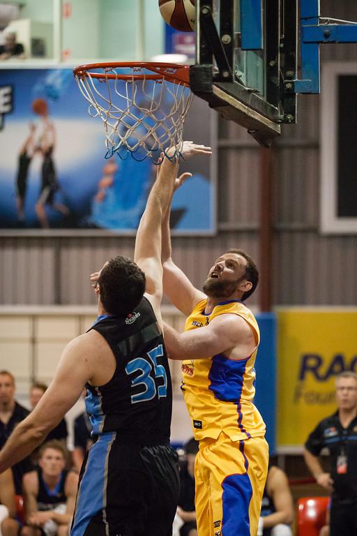 """Anthony Petrie, Alex Pledger - Adelaide 36ers v New Zealand Breakers - 2014 NBL Blitz Basketball, NAB Stadium, Auchenflower, Brisbane, Qld, AUS. Day 1. Photos by Des Thureson - <a href=""""http://disci.smugmug.com"""">http://disci.smugmug.com</a>."""