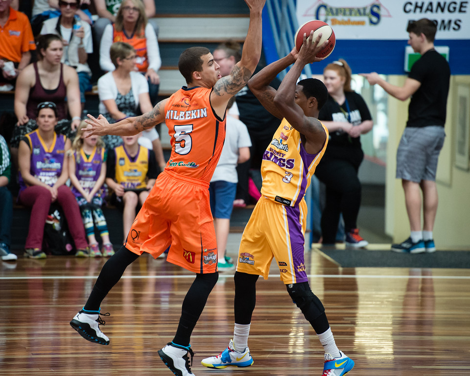 "Scott Wilbekin, Kendrick Perry - Cairns Taipans v Sydney Kings - 2014 NBL Blitz Basketball, NAB Stadium, Auchenflower, Brisbane, Qld, AUS. Day 3, Camera 1. Photos by Des Thureson - <a href=""http://disci.smugmug.com"">http://disci.smugmug.com</a>."