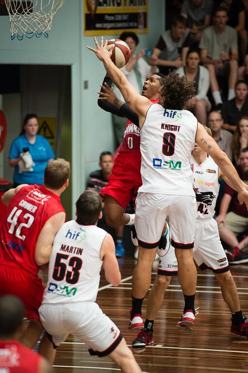"Jahii Carson, Matthew Knight - Perth Wildcats v Wollongong Hawks - 2014 NBL Blitz Basketball, NAB Stadium, Auchenflower, Brisbane, Qld, AUS. Day 3, Camera 1. Photos by Des Thureson - <a href=""http://disci.smugmug.com"">http://disci.smugmug.com</a>."