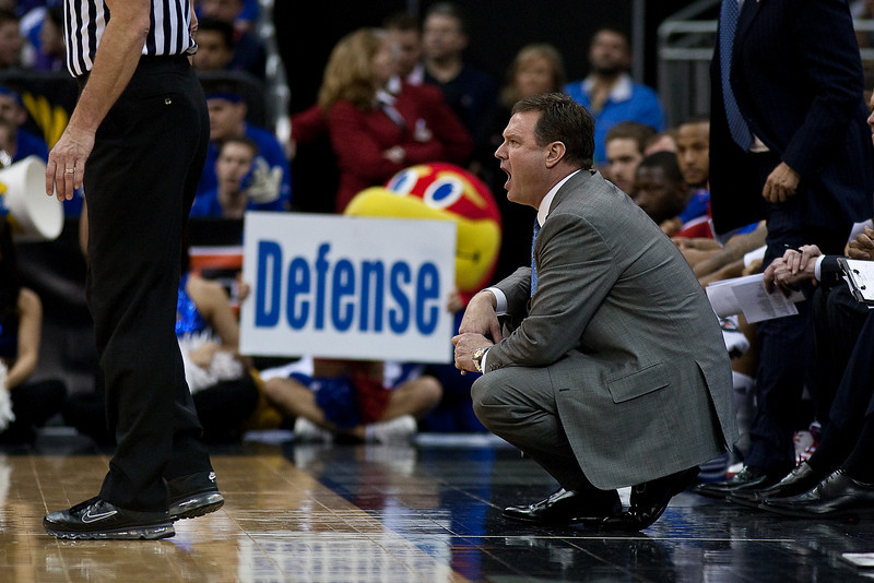 12 March 2010: Kansas Jayhawks head coach Bill Self encourages his team during the semifinals of the Phillips 66 Big 12 Men's Basketball Championship.  The Kansas Jayhawks defeated the Texas A&M Aggies 79-66 at Sprint Center in Kansas City, Missouri.