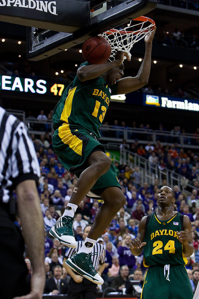 12 March 2010: Baylor Bears forward Ekpe Udoh (13) slam dunks during the semifinals of the Phillips 66 Big 12 Men's Basketball Championship.  The Kansas State Wildcats defeated the Baylor Bears 82-75 at Sprint Center in Kansas City, Missouri.