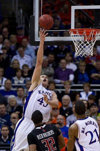 11 March 2010: Kansas Jayhawks center Cole Aldrich (45) goes up for a shot during the quarterfinals of the Phillips 66 Big 12 Men's Basketball Championship.  The Kansas Jayhawks defeated the Texas Tech Red Raiders 80-68 at Sprint Center in Kansas City, Missouri.