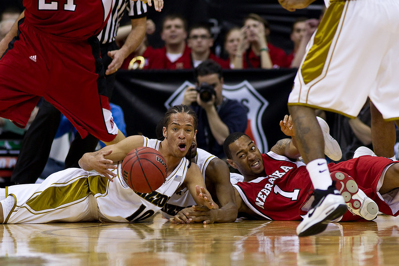 10 March 2010: Missouri Tigers guard Michael Dixon (10) and Nebraska Cornhuskers guard Eshaunte Jones (1) battle for a loose ball during the first round of the Phillips 66 Big 12 Men's Basketball Championship.  The Nebraska Cornhuskers defeated the Missouri Tigers 75-60 at Sprint Center in Kansas City, Missouri.