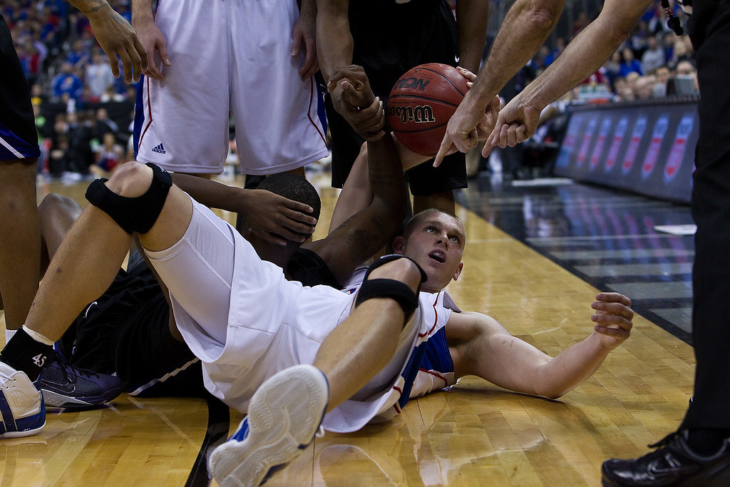 13 March 2010: Kansas Jayhawks center Cole Aldrich (45) scrambled for a loose ball and got tagged with a foul during the Phillips 66 Big 12 Men's Basketball Championship Final.  The Kansas Jayhawks defeated the Kansas State Wildcats 72-64 at Sprint Center in Kansas City, Missouri.