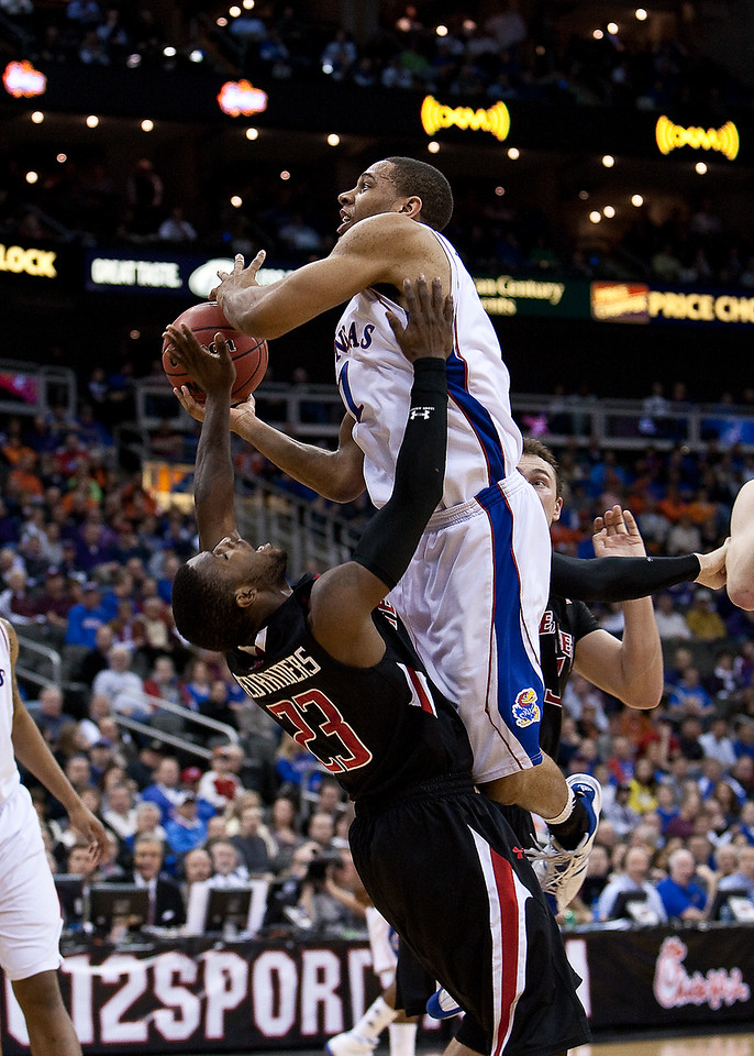 11 March 2010: Kansas Jayhawks guard Xavier Henry (1) goes up for a shot while Texas Tech Red Raiders guard Nick Okorie (23) tries to draw a charge during the quarterfinals of the Phillips 66 Big 12 Men's Basketball Championship.  The Kansas Jayhawks defeated the Texas Tech Red Raiders 80-68 at Sprint Center in Kansas City, Missouri.