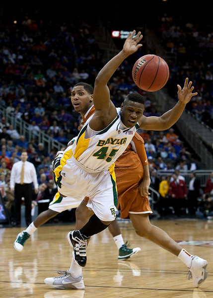 11 March 2010: Baylor Bears guard Tweety Carter (45) get fouled during the quarterfinals of the Phillips 66 Big 12 Men's Basketball Championship.  The Baylor Bears led the Texas Longhorns 43-39 at the half at Sprint Center in Kansas City, Missouri.